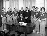 The first team of Sport Coaches mobilized to the State of Bahrain in 1977 join Academy President Dr. Thomas Rosandich (Center Right), Academy Trustee Dr. George Uhlig (Center Left) and University of South Alabama President Dr. Fred Whiddon (Seated, Center). The Bahrain Sport Education Program was the first major international contract for the Academy and it led to a continuous Academy presence in the island nation for some 10 years.
